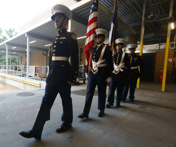 Members of the College Park High School Marine Corps JROTC practice their entrance before a graduation ceremony at Cynthia Woods Mitchell Pavilion, Monday, May 24, 2021, in The Woodlands. Photo: Jason Fochtman/Staff Photographer / 2021 © Houston Chronicle