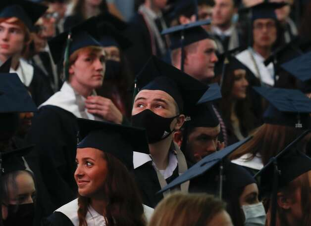 A College Park student watches a video during a graduation ceremony at Cynthia Woods Mitchell Pavilion, Monday, May 24, 2021, in The Woodlands. Photo: Jason Fochtman/Staff Photographer / 2021 © Houston Chronicle
