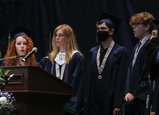 College Park students sign the national anthem during a graduation ceremony at Cynthia Woods Mitchell Pavilion, Monday, May 24, 2021, in The Woodlands. Photo: Jason Fochtman/Staff Photographer / 2021 © Houston Chronicle