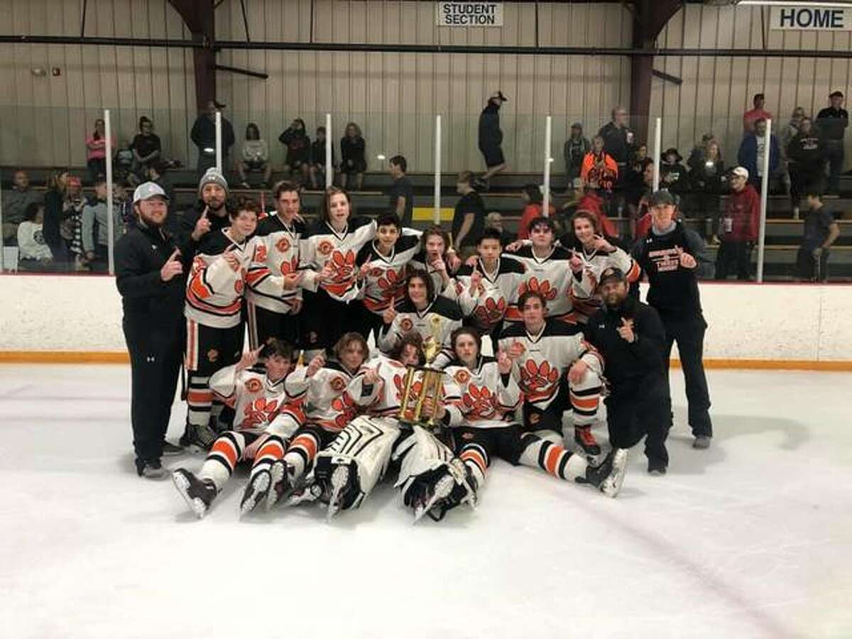The Edwardsville North junior varsity ice hockey team poses with the Mississippi Valley Club Hockey Association championship after defeating the Granite City Warriors in Game 2 of the best-of-three series. The Tigers won Game 1 6-0 behind two goals apiece from Fred Bramstedt, David Hensley and Luke Thomilson and won Game 2 4-0 behind two goals from Konnor Goclan and a goal apiece from Logan Betts and Bramstedt. Kai Vetter made 25 saves in the two shutout wins.