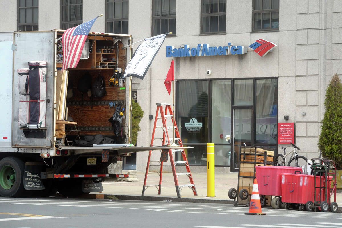 """Trucks and equipment stand outside a film set near the intersection of Wall and Rivers Streets where scenes for """"The Good Nurse"""" are being filmed in Norwalk, Conn. May 24, 2021."""