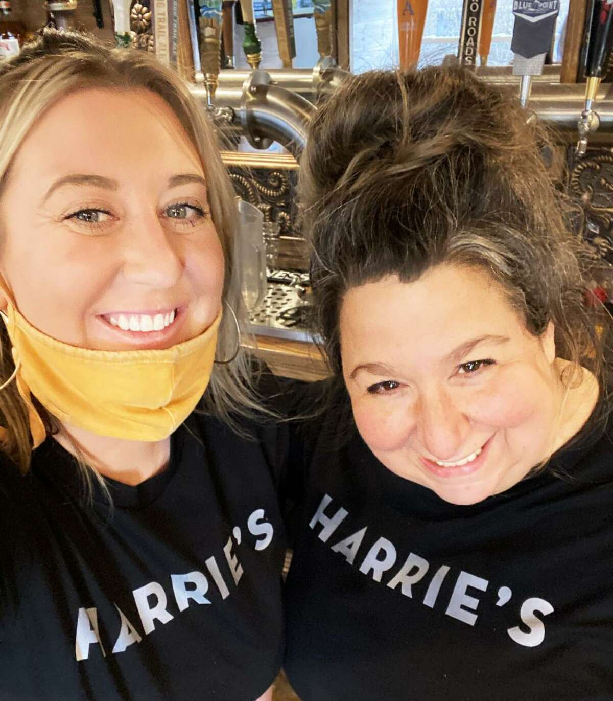 Carrie Carella, right, who owns NoRA Cupcake Co. of Middletown, and Heather Kelly, who worked for Carella at NoRA, recently launched Harrie's Jailhouse in the old Pameacha Jail on Warwick Street. The pub-style restaurant features gourmet sandwiches, bar snacks, and signature cocktails with a nod to the building's history, such as The Capone and The Pen.