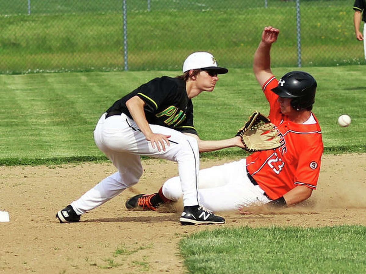 Gillespie's Kamryn Link (right) slides in with a stolen base while Southwestern second baseman Cale Schuchman takes the throw in the first inning on Monday in Gillespie.