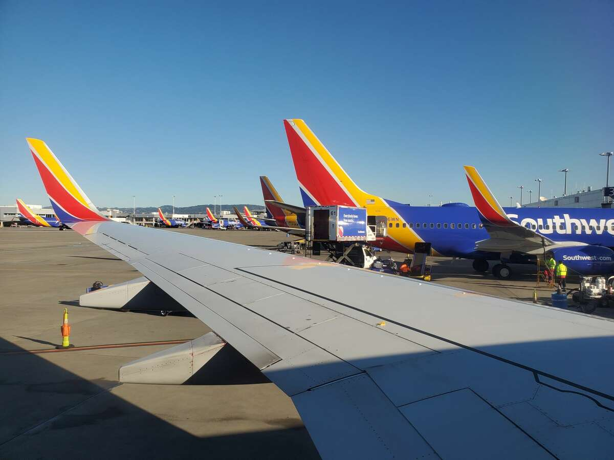 View over wing of Southwest Airlines aircraft towards other aircraft on tarmac at Oakland International Airport (OAK) in Oakland, California, January 5, 2020.