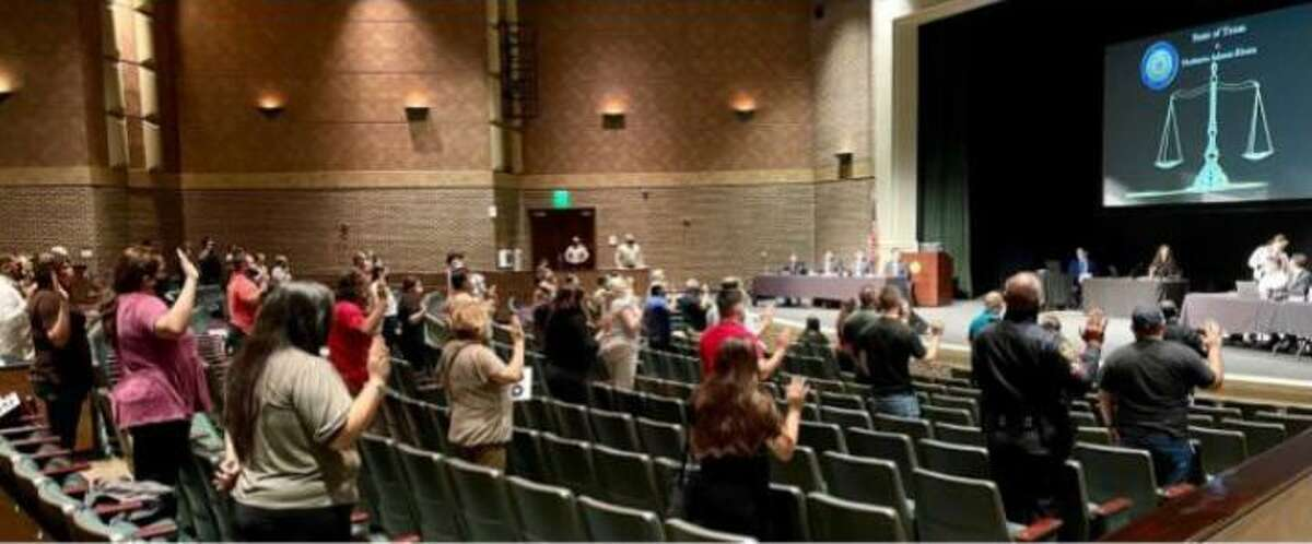 Prospective jurors are shown being sworn-in for jury selection at the Laredo College Martinez Fine Arts Center.