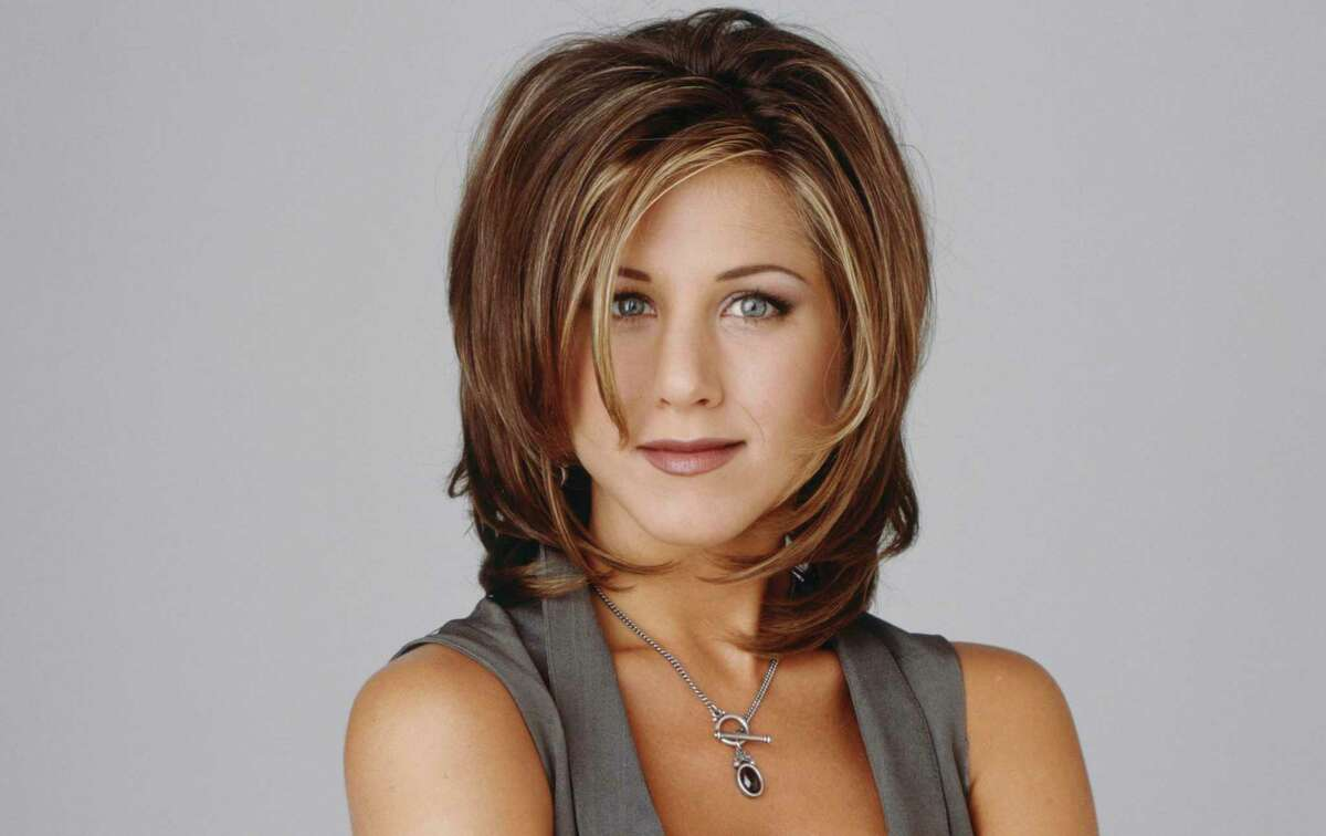 """Actress Jennifer Aniston wears The Rachel, the hairstyle she made famous on the TV show """"Friends."""""""