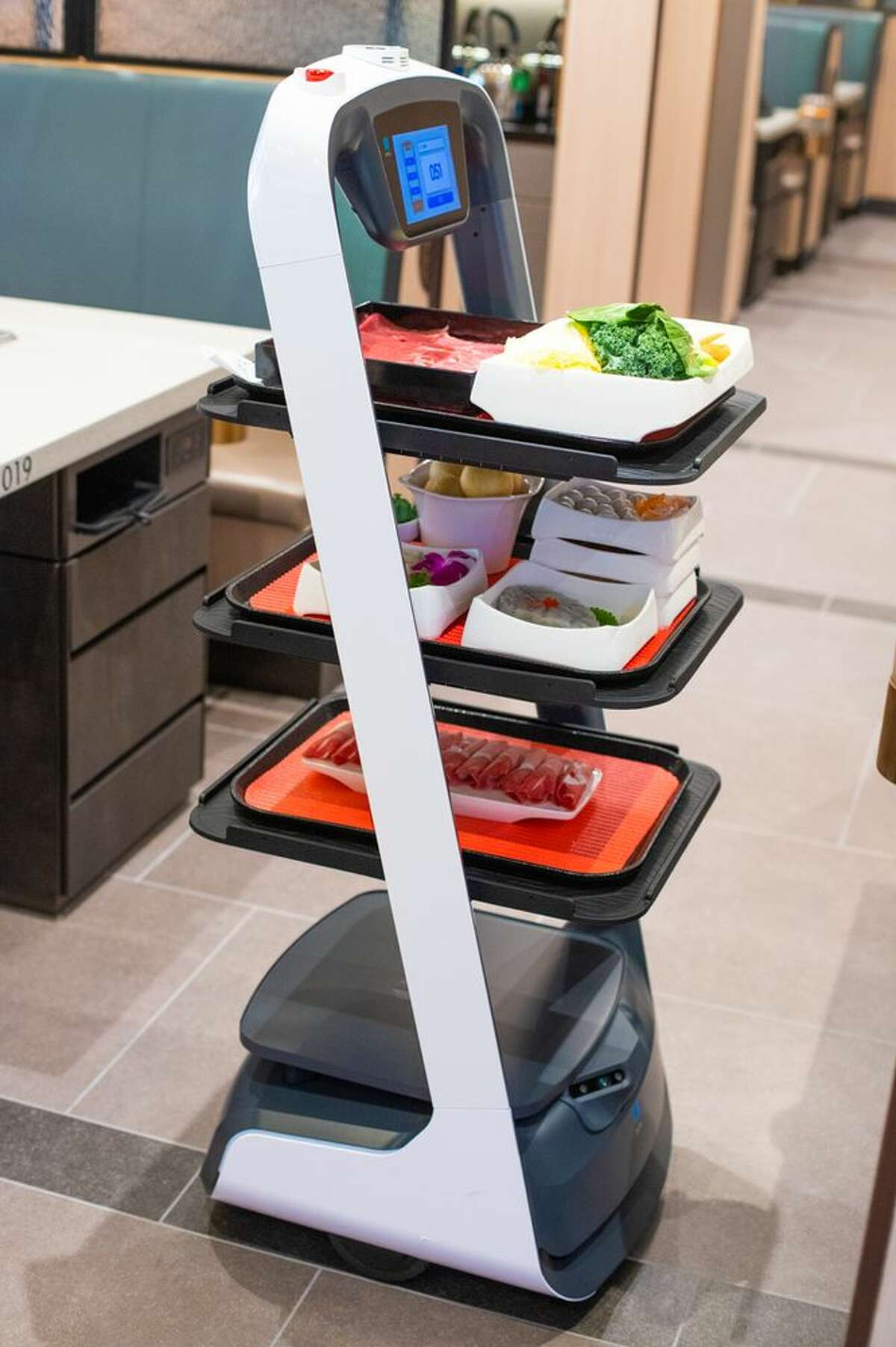 The Katy location features robot servers found at the global chain's other locations. (Courtesy HaiDiLao/Yelp)