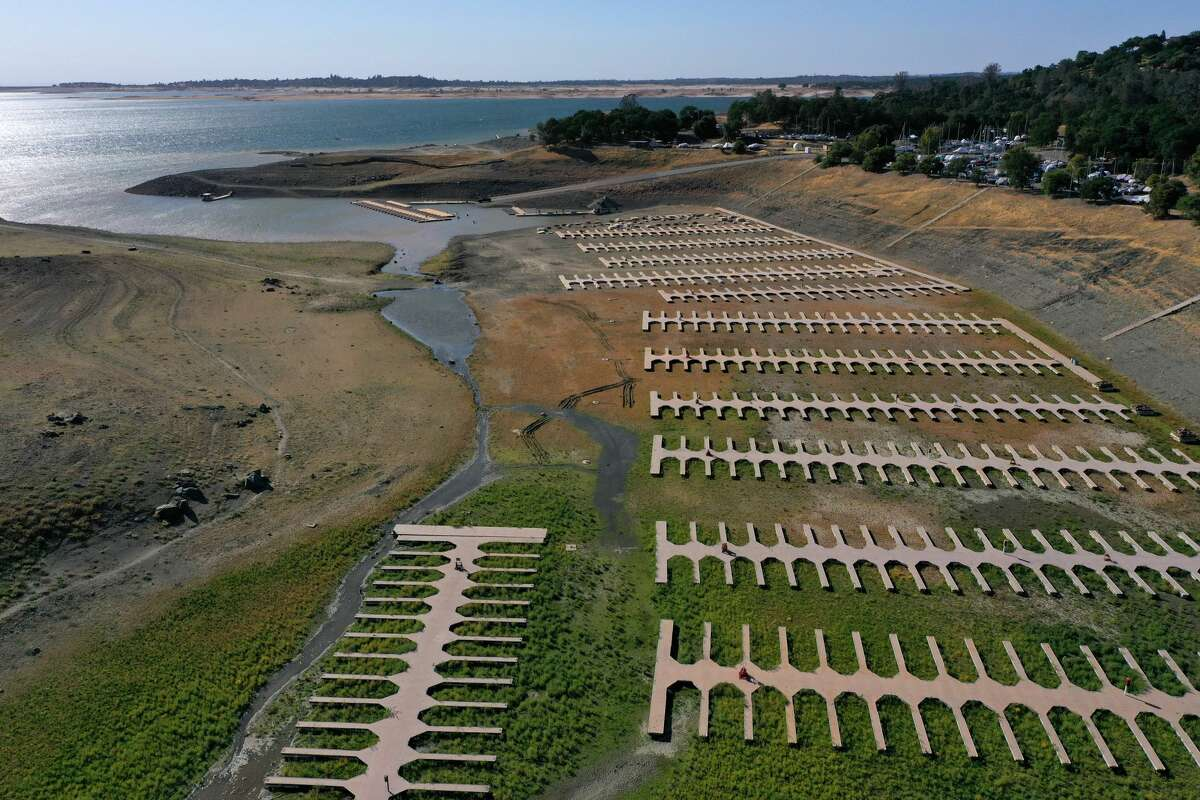 In an aerial view, boat docks at the Browns Ravine Cove sit on dry earth at Folsom Lake on May 10, 2021 in El Dorado Hills.