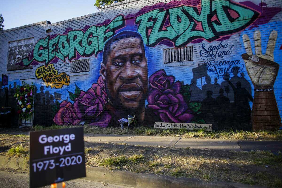 A mural of George Floyd on the side of a building is seen at the intersection of Elgin Street and Ennis Street in the 3rd Ward on June 10, 2020 in Houston, Texas.