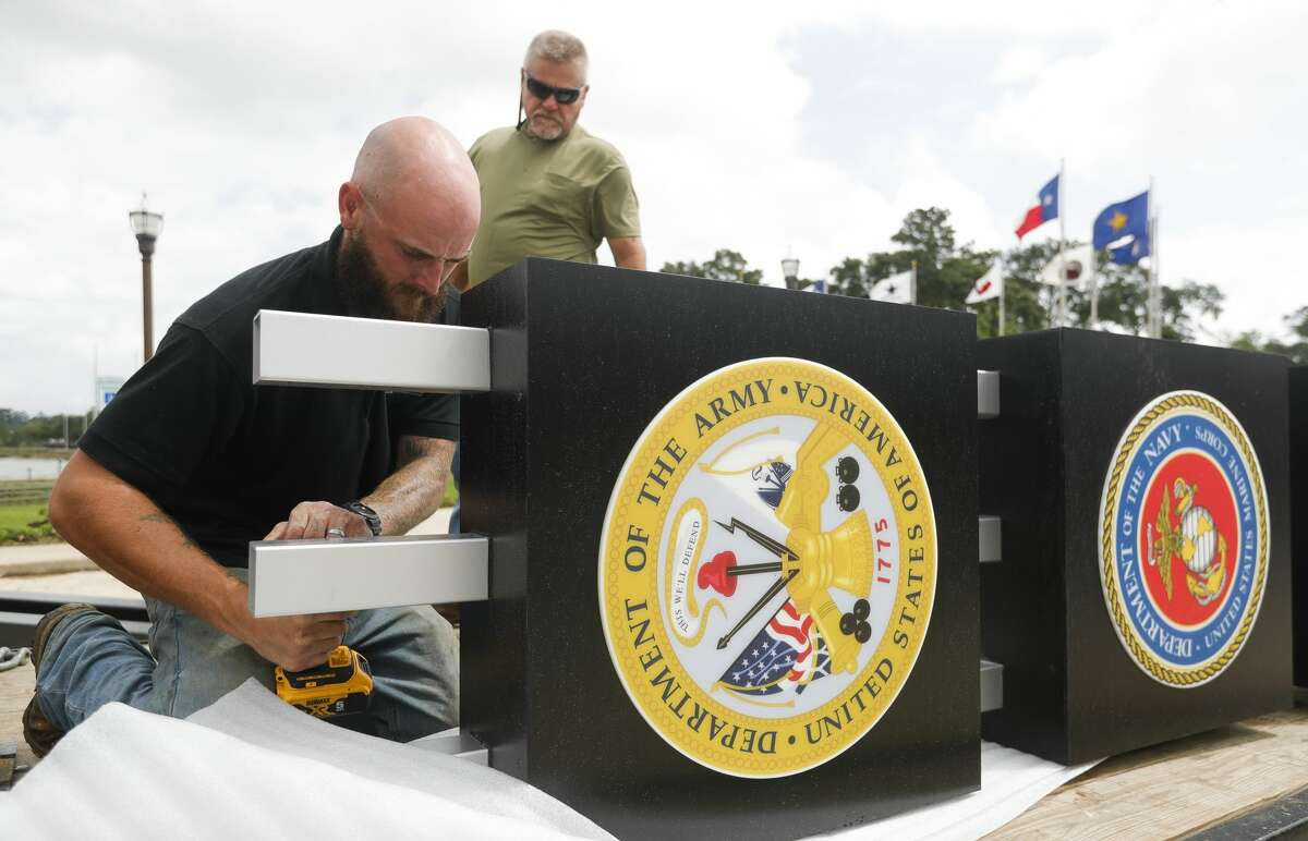 Austin Hayden with Bakers' Signs and Manufacturing works to install a gateway in honor of military service branches at the Montgomery County Veterans Memorial Park, Tuedsay, May 25, 2021, in Conroe. Park organiziers will hold a cremony dedicating several monuments on Memorial Day at 11:00 a.m.