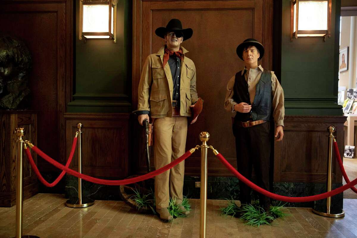 """Wax figures of John Wayne as he appeared in """"True Grit"""" and Dustin Hoffman in """"Little Big Man"""" are in display at the Briscoe Western Art Museum as part of the exhibit """"Still in the Saddle: A New History of the Hollywood Western."""""""