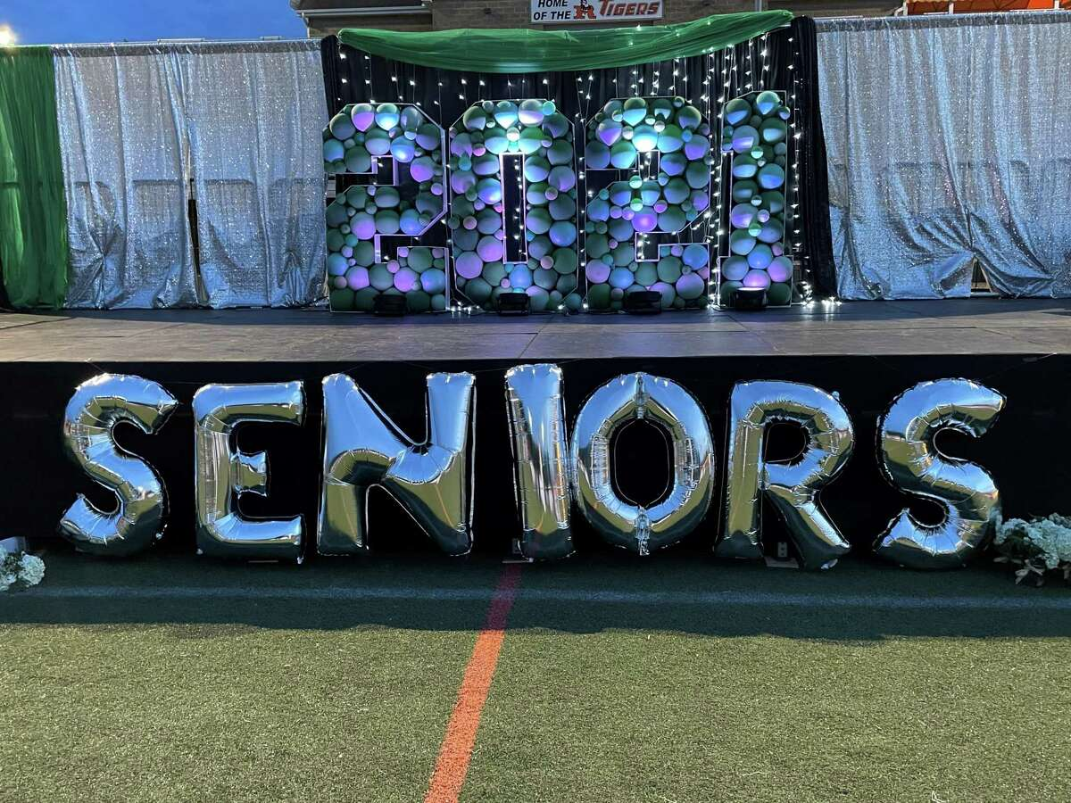 Themed balloons greeted graduating seniors who gathered at Tiger Hollow stadium on Friday, May 21 for a semi-formal celebration in place of the usual prom.