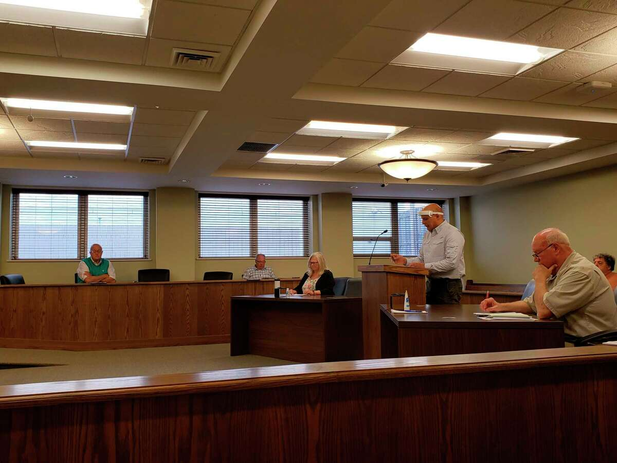 The Huron County Board of Commissioners during this week's meeting held in the district courtroom. The meeting was mostly focused on a discussion on how to reopen the Oak Beach boat launch. (Robert Creenan/Huron Daily Tribune)