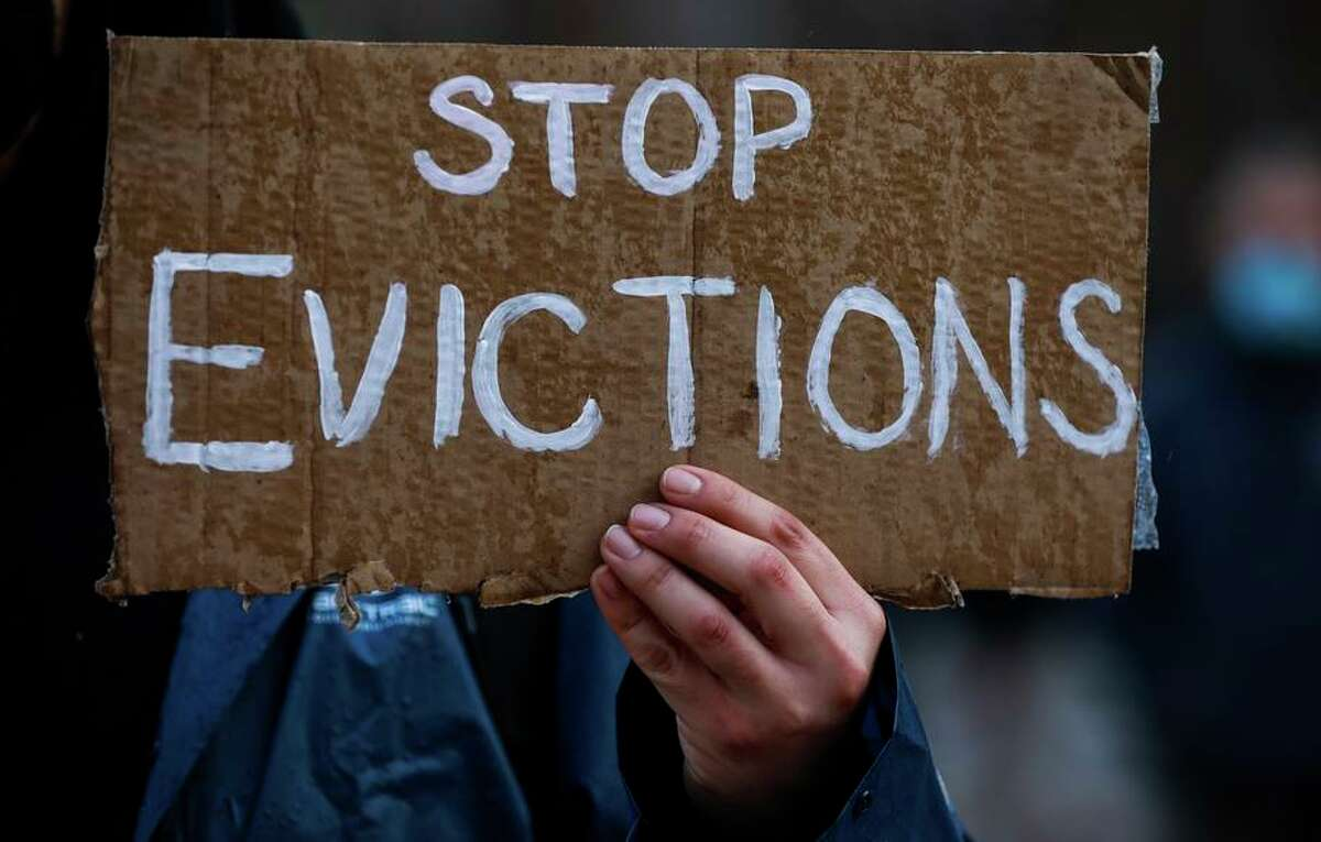 Demonstrator Roach D. holds a sign reading �Stop Evictions� outside the Santa Clara County Courthouse in San Jose to halt eviction proceedings from taking place on Wednesday, Jan. 27, 2021 in San Jose, California.