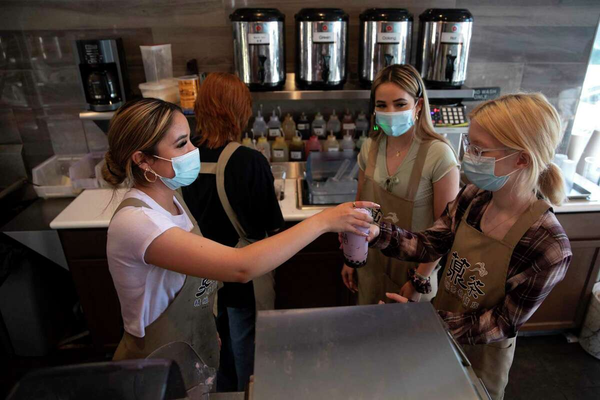 Twins Denise and Valerie Longoria (left and center) are preparing to graduate from Harlan High School near the top of their class. The sisters both work at the same bubble tea shop, and are their class president and vice-president.