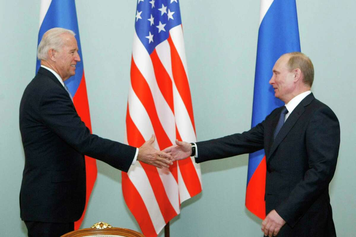 FILE - In this March 10, 2011, file photo, then Vice President Joe Biden, left, shakes hands with Russian Prime Minister Vladimir Putin in Moscow, Russia. The White House and the Kremlin are working to arrange a summit between President Joe Biden and Russian President Vladimir Putin in Switzerland in June. (AP Photo/Alexander Zemlianichenko, File)