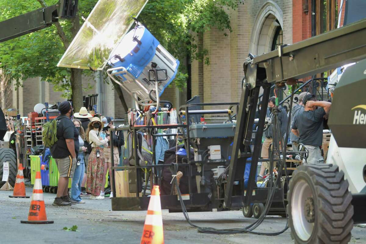 Crews working outside a home on 3rd St., where inside the home filming was taking place for the HBO show, The Gilded Age, on Tuesday, May 25, 2021, in Troy, N.Y. (Paul Buckowski/Times Union)