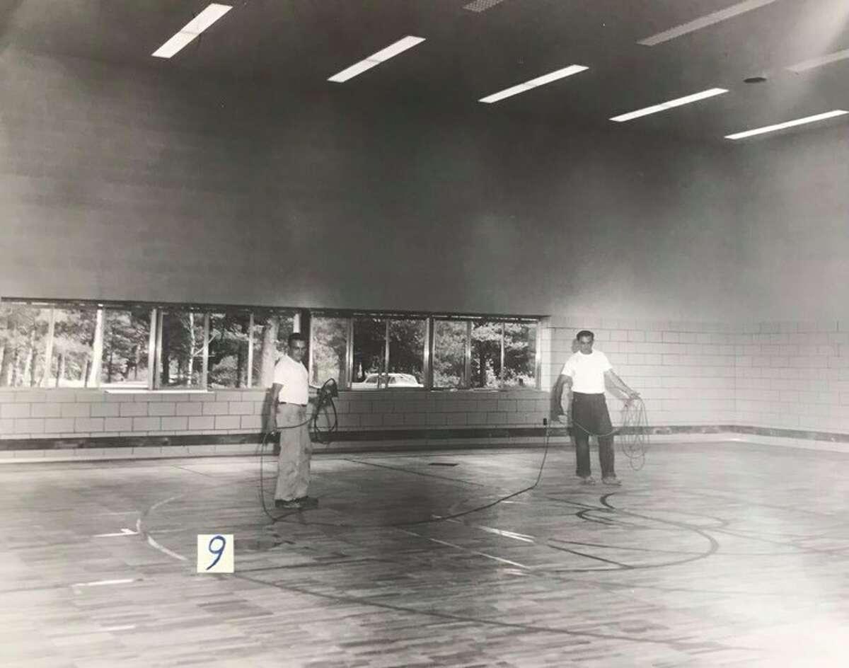 Work on the gymnasium floor at Siebert Elementary School. 1958