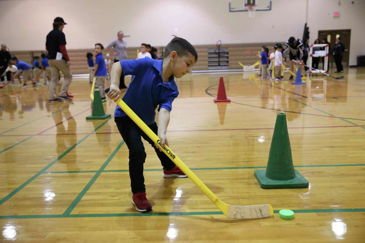 Kinder student Jaxson Flores, 5, runs a drill during a physical education class at Mission Academy in Jan. 2020. SAISD students in kindergarten through 8th grade will be getting a new health and physical education curriculum starting in the Fall.