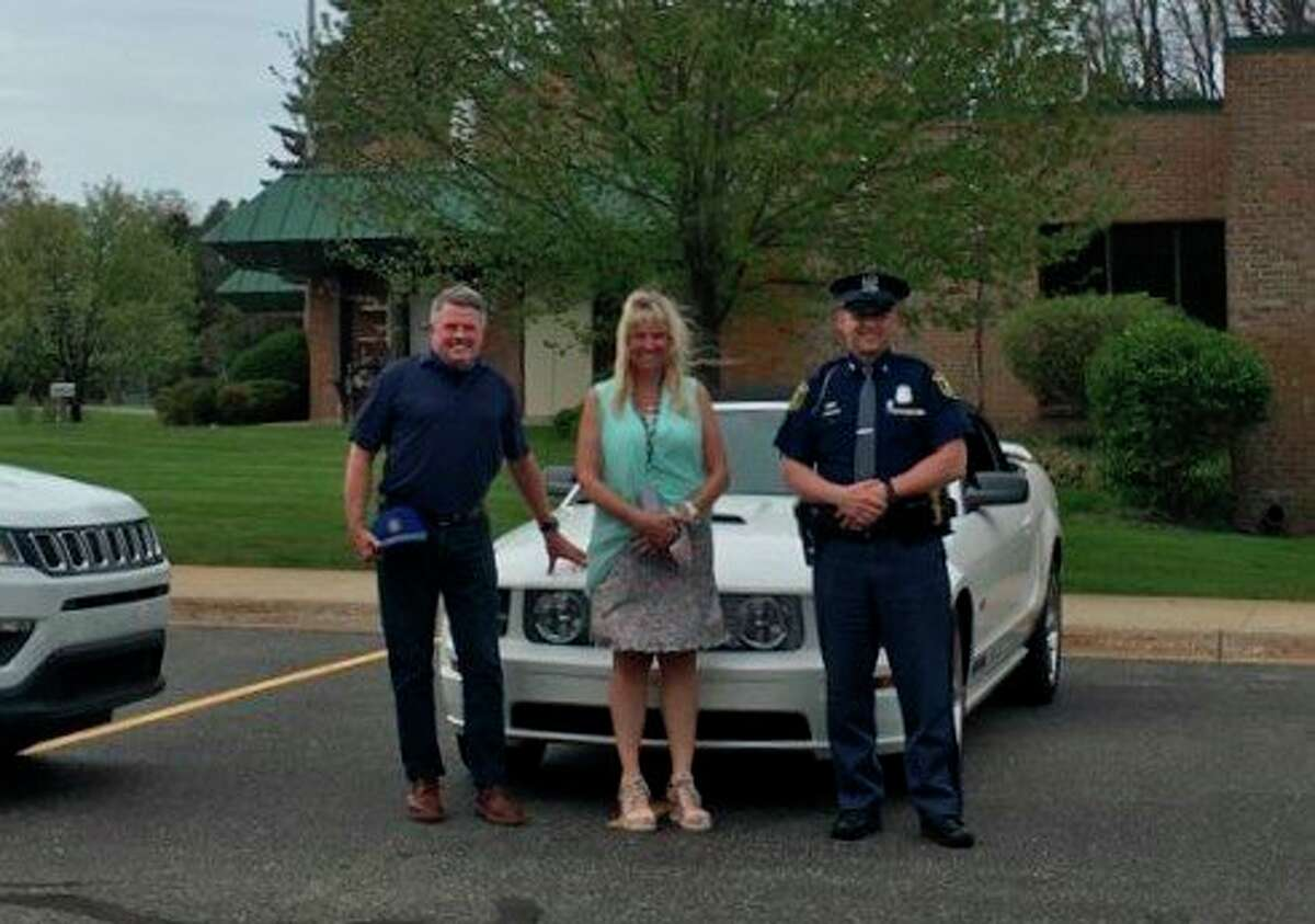 Jim Massaroni of Team One Credit Union (left); Brooke McIsaac, special education director of the Manistee Intermediate School District; and Michigan State Police Trooper David Prichard pose for a photo during aVulnerable or Impaired Person enrollment event at the Manistee ISD on May 19. (Courtesy photo)