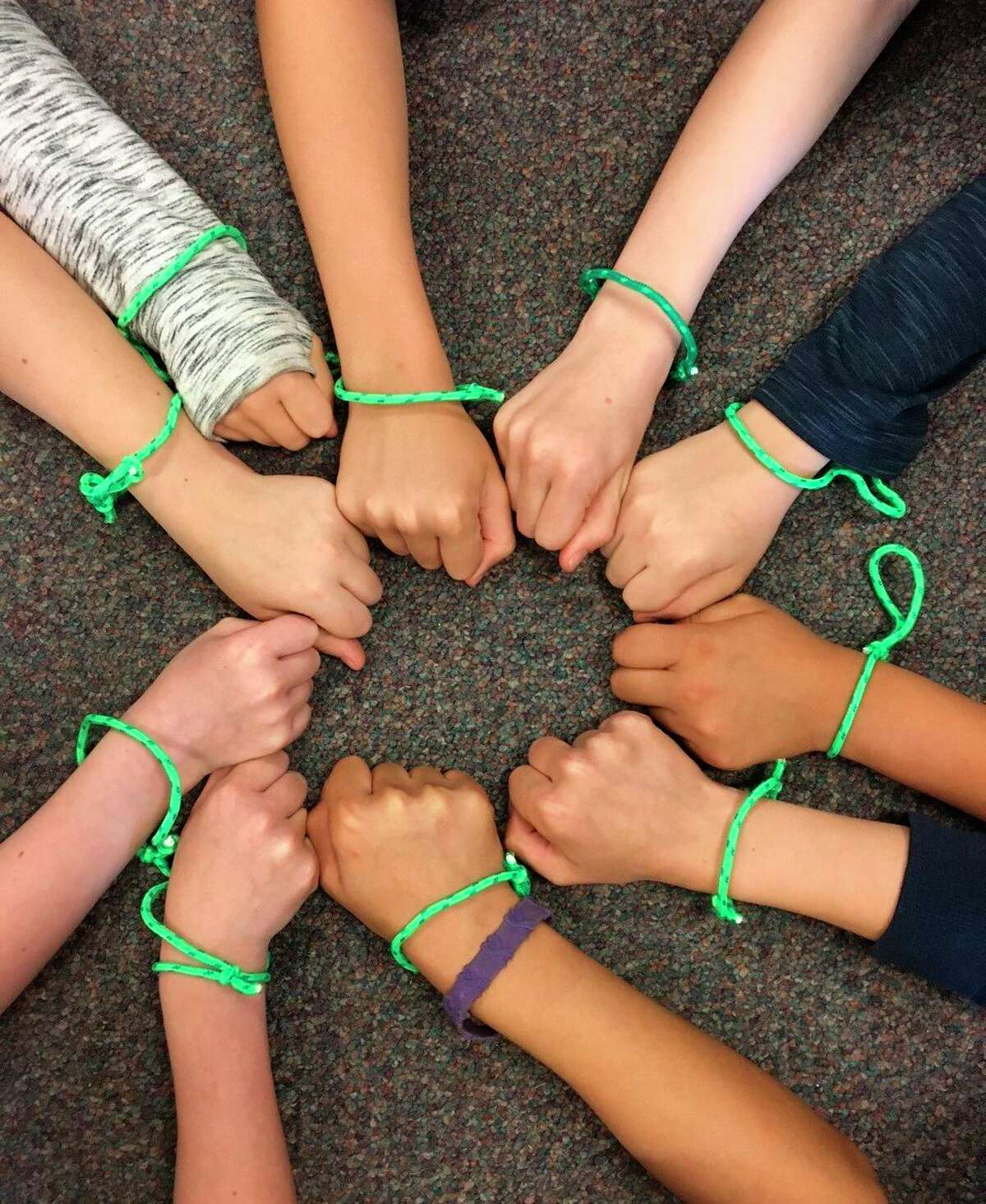 Fourth-grade students in Tracy Bennett's class at Onekama Consolidated Schools wore green bracelets in honor of Mental Health Awareness Month. (Courtesy photo)