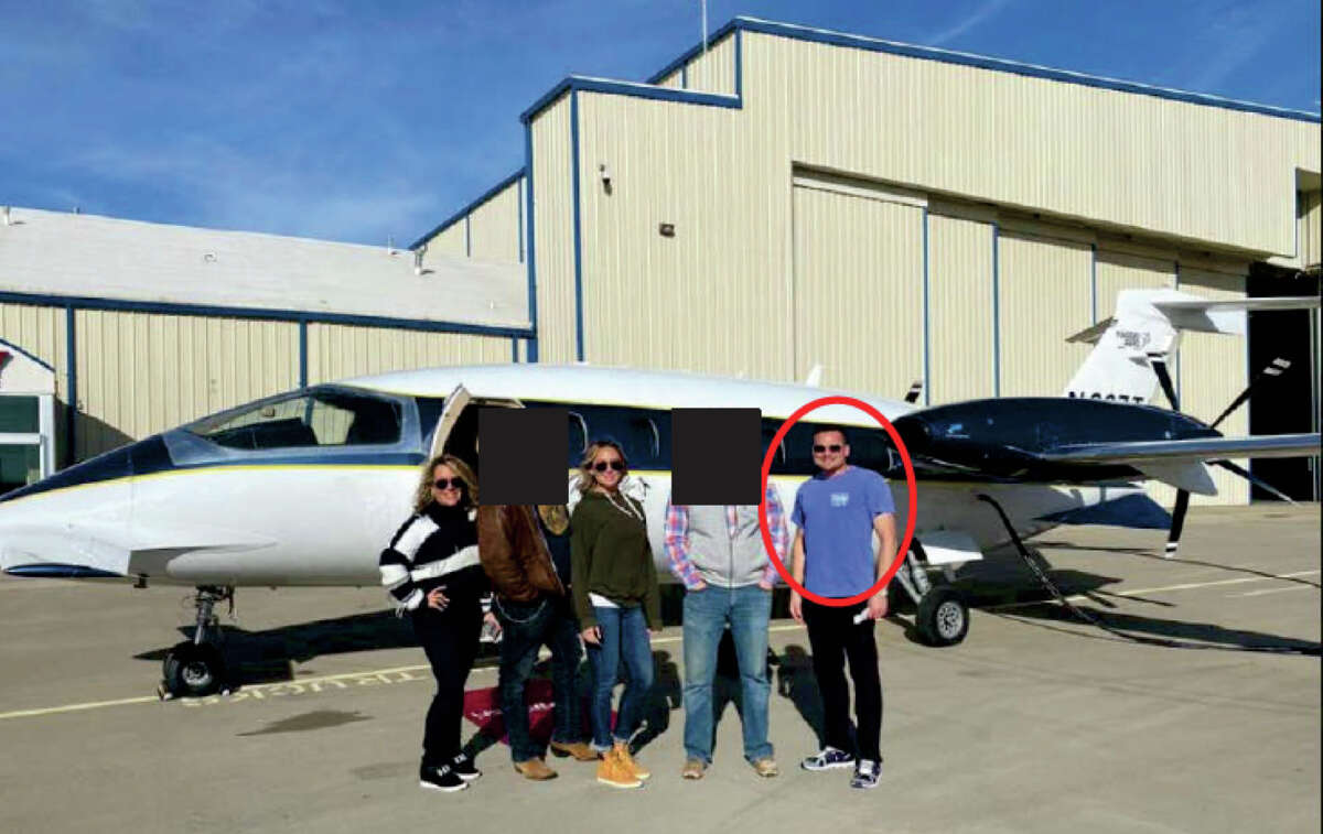Jason Hyland, of Frisco, Texas, stands at the far right of this photo posted on Twitter. Hyland chartered the so-called