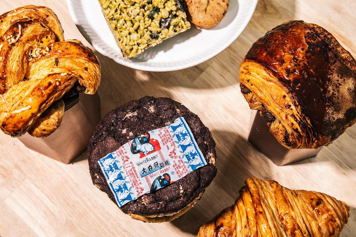 Clockwise from top left: Aloha croissant, matcha cookies n' cream rice krispies treat, mochi bite, hojicha chocolate croissant, traditional croissant, and a cocoa white rabbit cookie are seen at Sunday Bakeshop in Oakland, Calif., Wednesday, May 12, 2021.