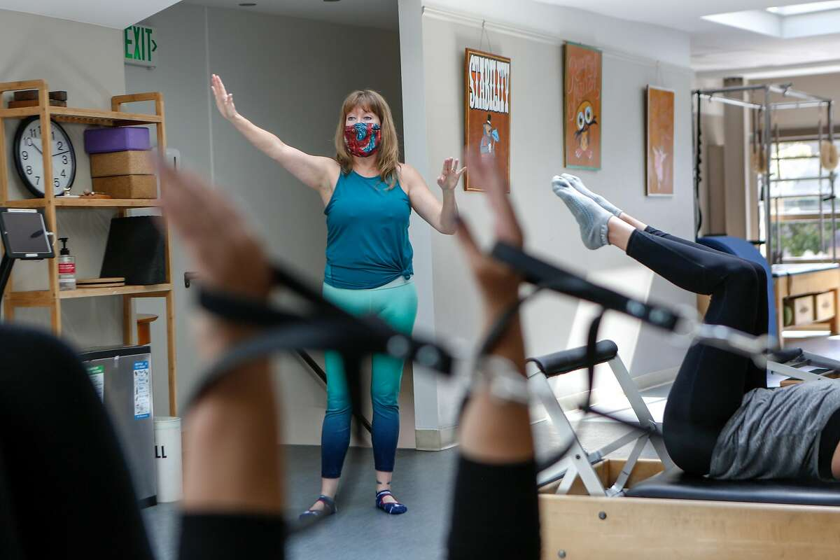 Instructor Myra Phipps teaches an in-person class at EHS Pilates Studio on Tuesday, May 25, 2021 in San Francisco, Calif.