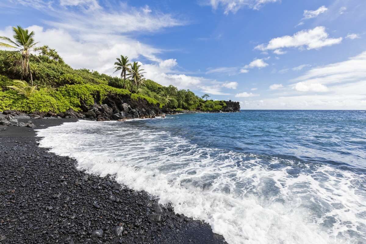 The black sand beach at Waianapanapa State Park is known around the world, but its popularity has also seen swarms of visitors. The park recently implemented a new reservation and fee system to manage visitors.
