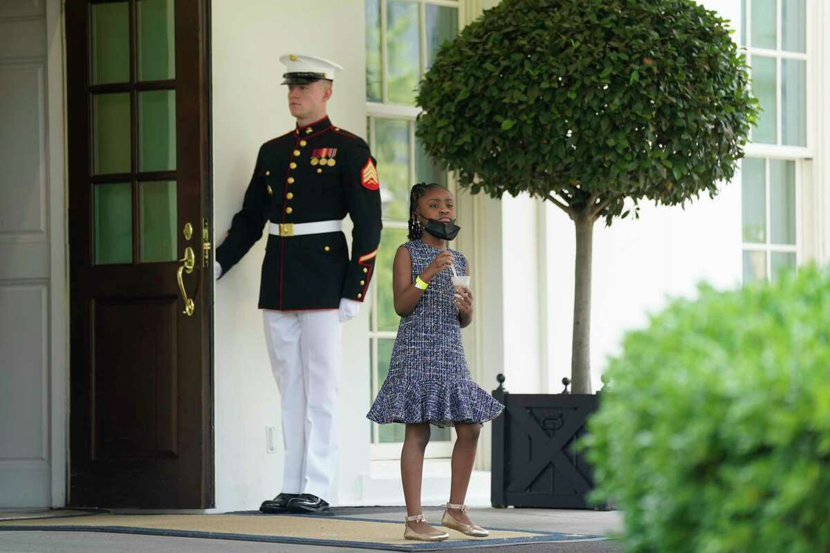 Gianna Floyd, the daughter of George Floyd, walks out of the West Wing door at the White House, Tuesday, May 25, 2021, in Washington.