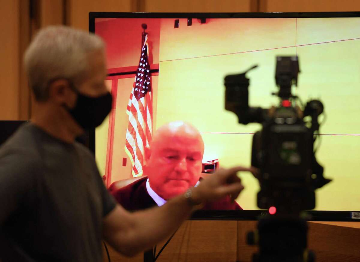 Judge John F. Blawie speaks during Michelle Troconis' virtual hearing at the Connecticut Superior Court in Stamford, Conn. Tuesday, May 25, 2021. Judge John F. Blawie approved a request from Michelle Troconis' attorney for a copy of a family psychological report produced during the contentious Dulos divorce, but held off on setting a date for the case to go to trial. Troconis, 46, has pleaded not guilty to charges of conspiracy to commit murder, tampering with evidence and hindering prosecution in connection with Jennifer Dulos' May 24, 2019 disappearance. She remains free on more than $2 million bond.
