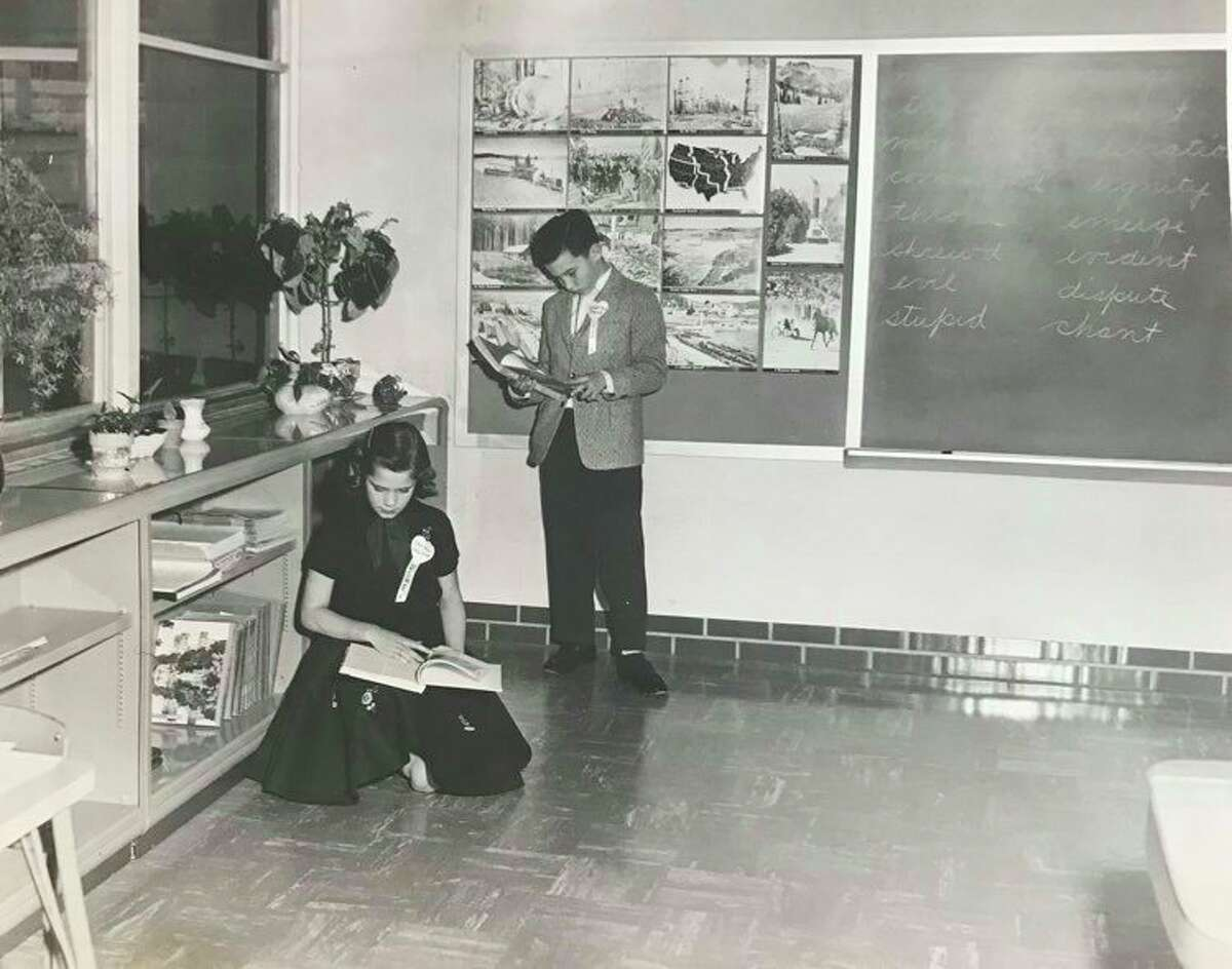 Chrissi Hayhoe and Charles Trask served as ushers for Siebert Elementary School's dedication ceremony. February 1959.