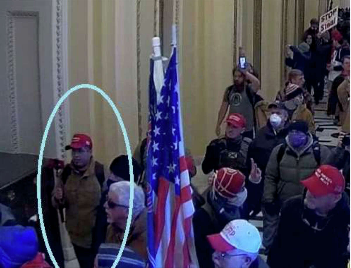 Surveillance footage shows Samuel Montoya of San Marcos, Texas, filming inside the Capitol, according to charging documents. Montoya worked for the right-wing conspiracy site Infowars.