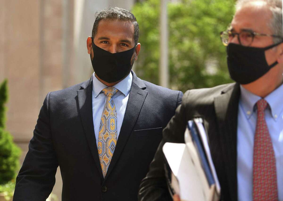 State Sen. Dennis Bradley, D-Bridgeport, exits his arraignment on wire fraud charges in federal court in New Haven, Conn. on Tuesday, May 25, 2021.