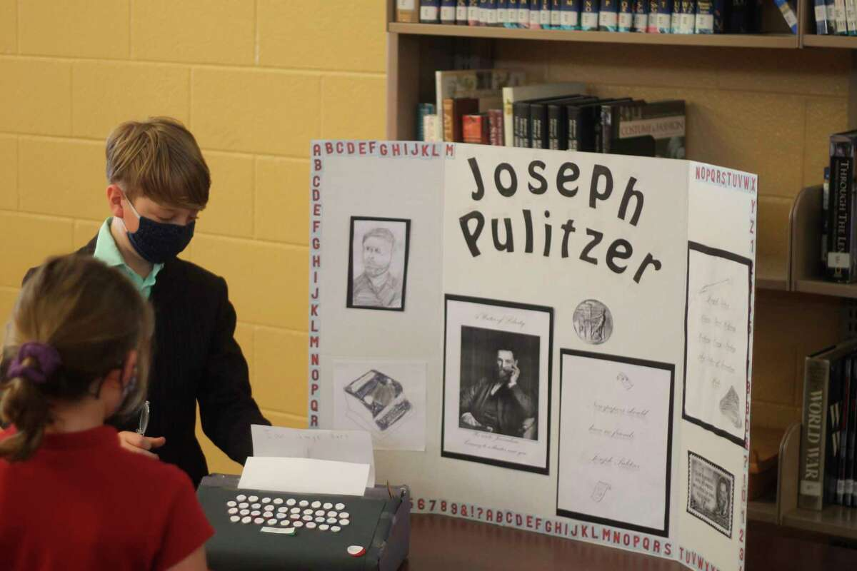 A Manistee Catholic Central student gives a presentation as Joseph Pulitzer during the sixth annual Famous Americans Wax Museum on Tuesday. (Kyle Kotecki/News Advocate)