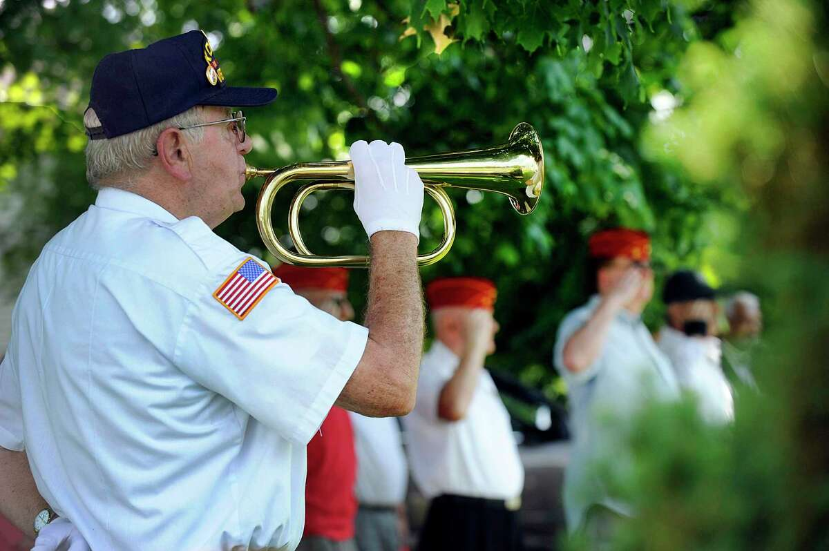 Kenneth E. Post, Jr. plays Taps at the conclusion of a ceremony Monday, July 16, 2018, at the Korean War Monument at Rogers Park. Hannah Y Kim, stopped in Danbury Monday, July 16, 2018, as part of an ambitious three-month journey visiting Korean War memorials in all 50 states, to honor and remember those who served that conflict, 1950-53, and to help promote peace on the Korean Peninsula.