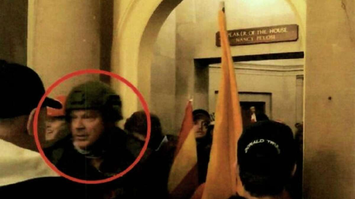 Larry Brock of Grapevine, Texas, in a crowd of rioters outside House Speaker Nancy Pelosi's office.