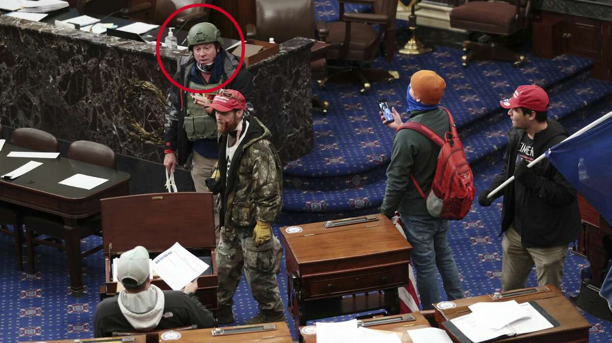 Larry Brock, of Grapevine, Texas, on the floor of the U.S. Senate during the Capitol riot.
