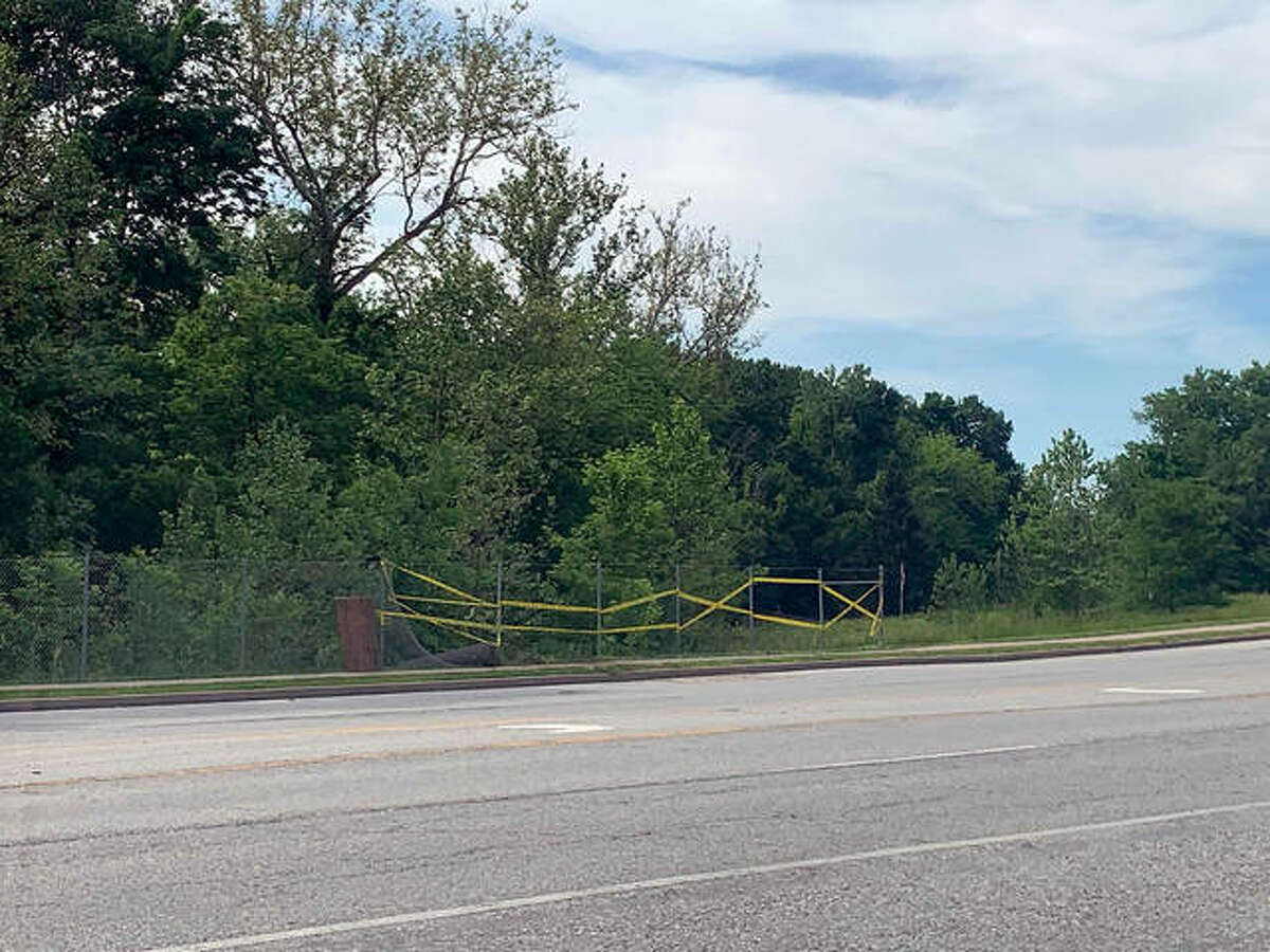 A pickup truck driver hit some highway signs and a section of fence after his truck left Route 157 and landed in a wooded area Monday night.