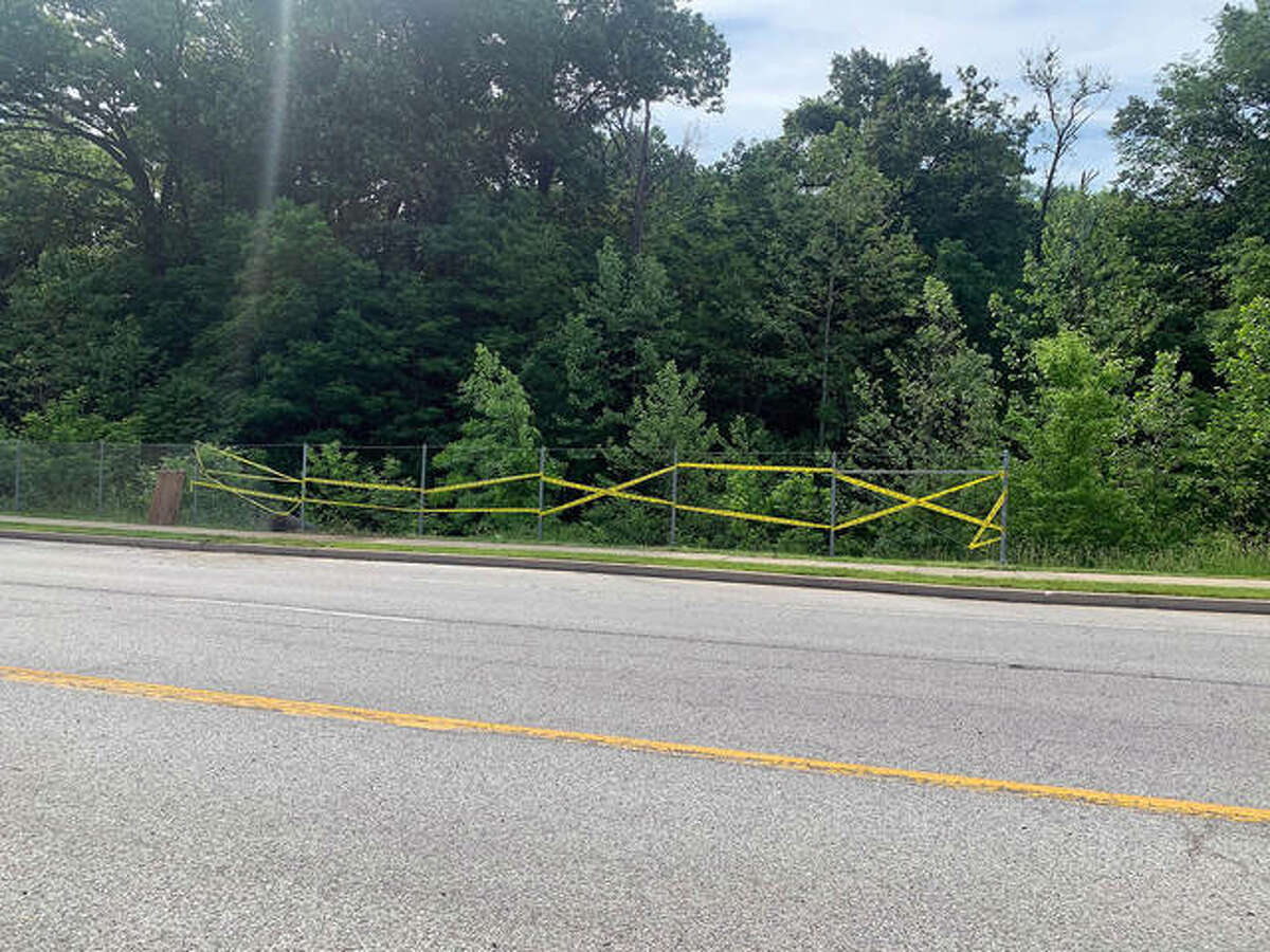 Caution tape between fence posts warns drivers and pedestrians to stay away from the area after a mid-evening crash Monday.