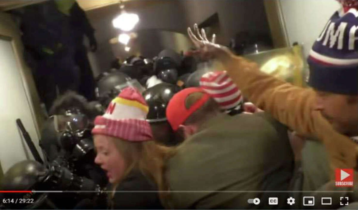 Federal officials say video uploaded to YouTube shows Jeovanny Montano of Pasadena, Texas, who they identify as the man in the Trump beanie, can be seen among the crowd fighting police in the Lower West Terrace Tunnel, according to charging documents.