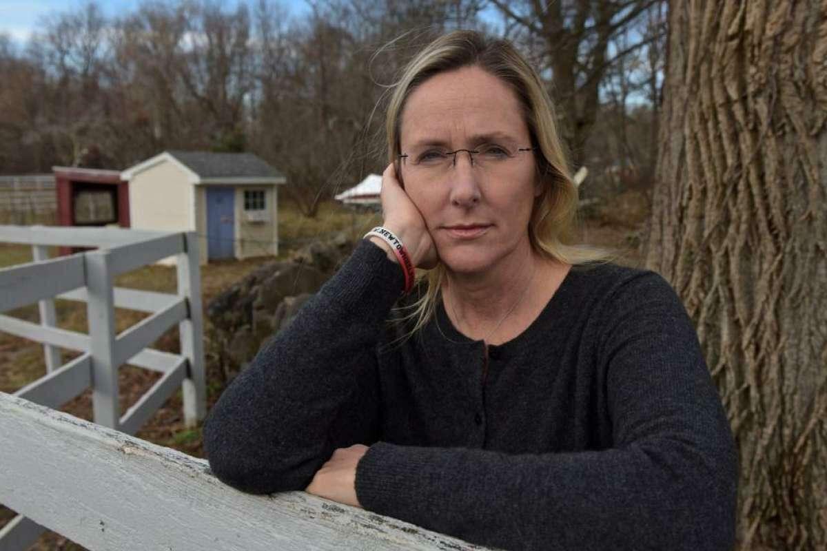 Scarlett Lewis stands in the yard of her Sandy Hook home. Lewis lost her son, Jesse Lewis, in the Sandy Hook School shooting.