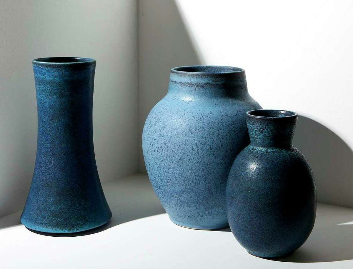 Some of Warner Walcott's ceramics creations, from left, Lucie vase in pitch combo, cordate vase in washed cenim, cone-necked barrel vase in pitch combo.