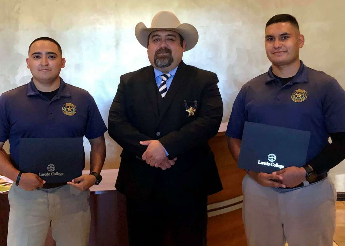 Cadets Hector Solis and Edgar Botello pose for a photo with Zapata County Sheriff Raymundo Del Bosque Jr. after graduating from the Laredo College Regional Law Enforcement Academy Class A-21.