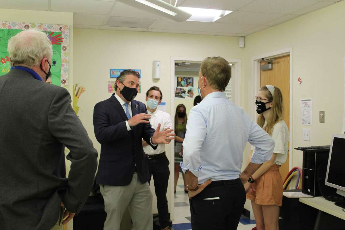 Boys & Girls Club of Ridgefield CEO Mike Flynn, center, shows Gov. Ned Lamont, right, the classrooms and recreational spaces that comprise the club.