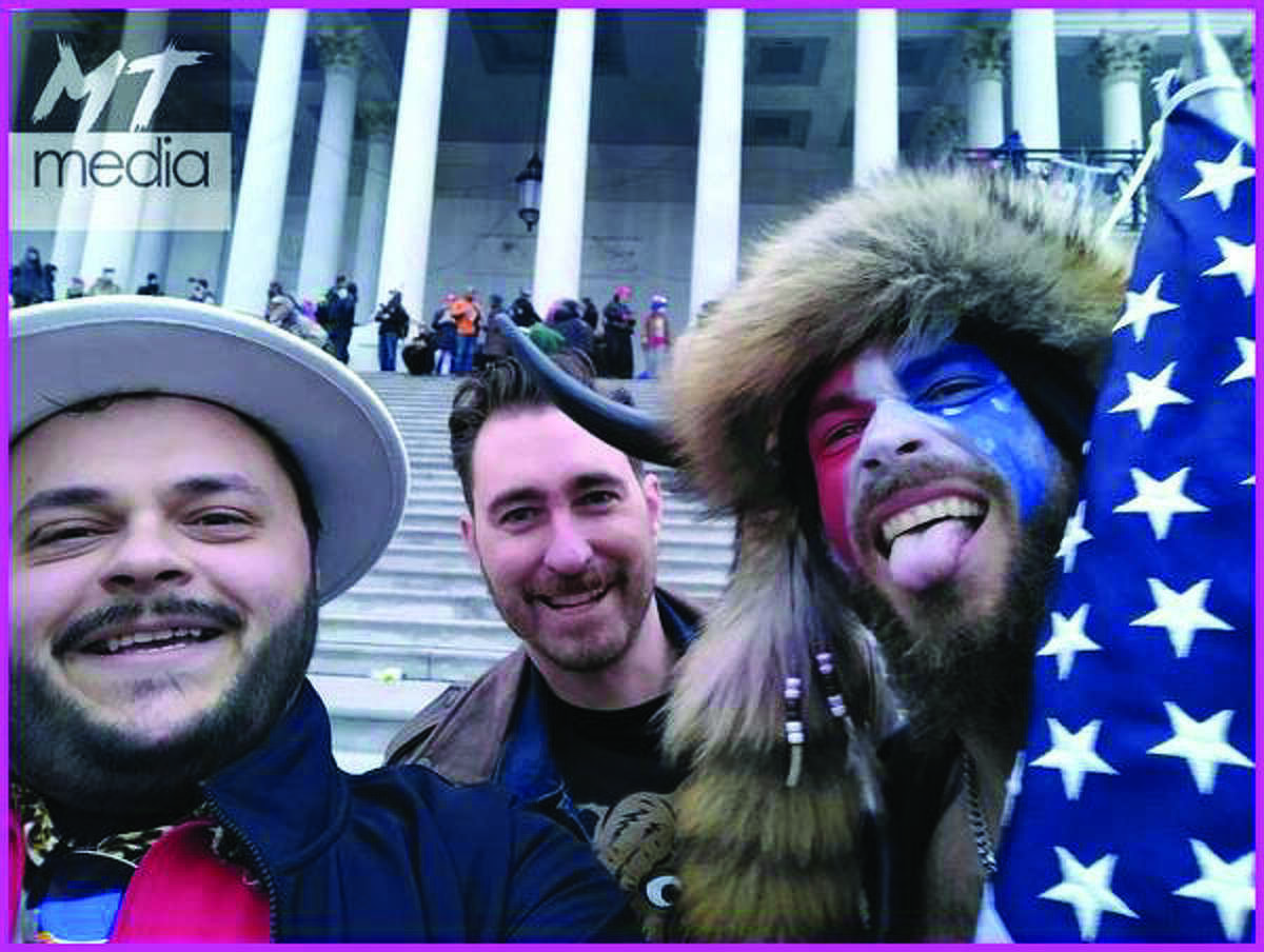 Nick DeCarlo of Burleson, Texas, poses with Nicholas Ochs, the founder of the Hawaii Proud Boys -- a right-wing group of self-described