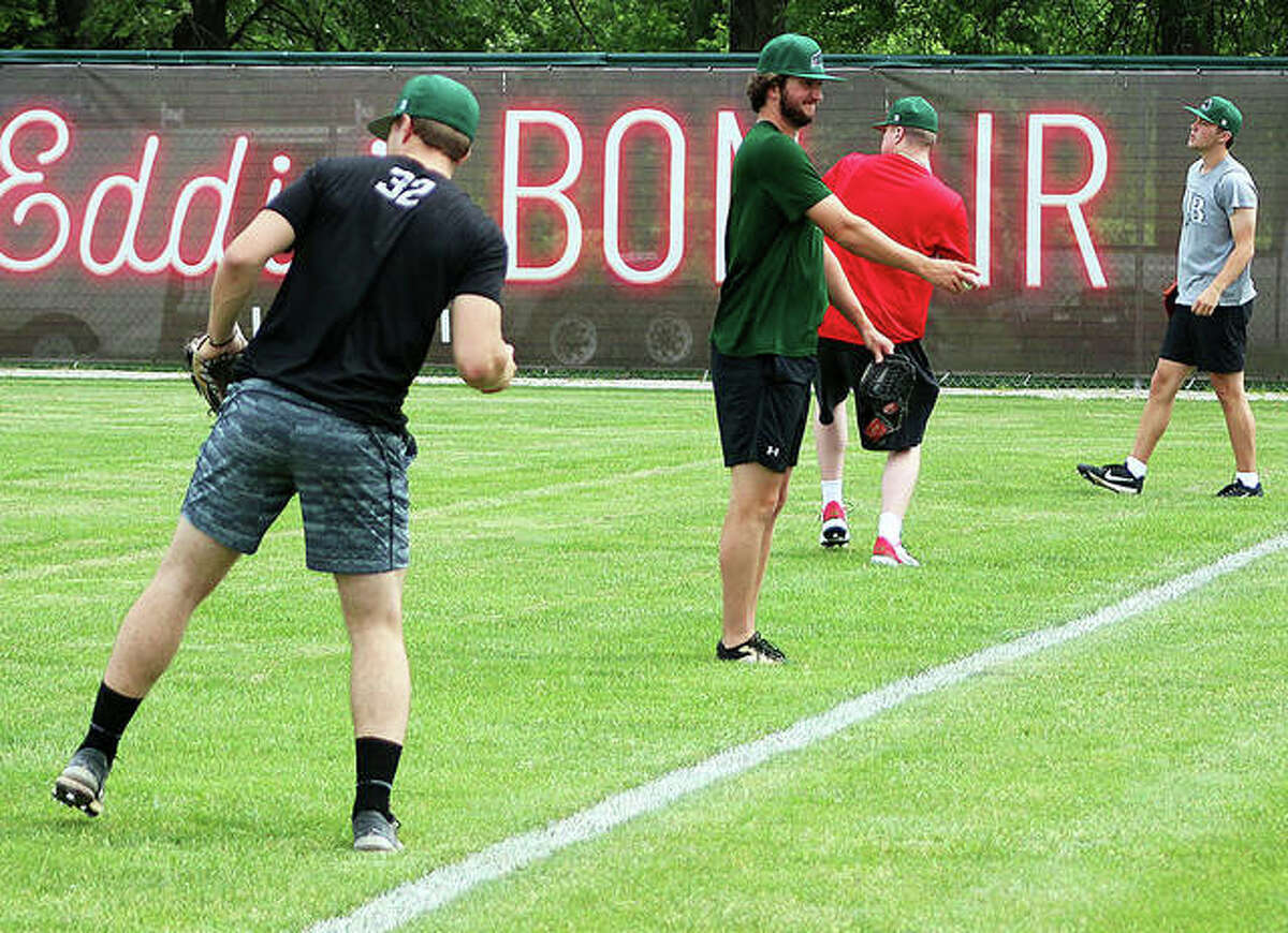 A group of Alton River Dragons players loosen up in the outfield after a team meeting Monday at Lloyd Hopkins Field in Gordon Moore Park. Monday was the first day for players to report. More are expected this week, with about 20 here in time for Thursday night's season opener against Cape Girardeau.