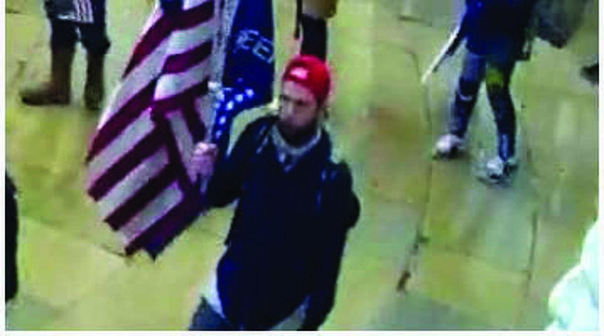 Surveillance footage shows Garrett Miller of Richardson, Texas, inside the Capitol.