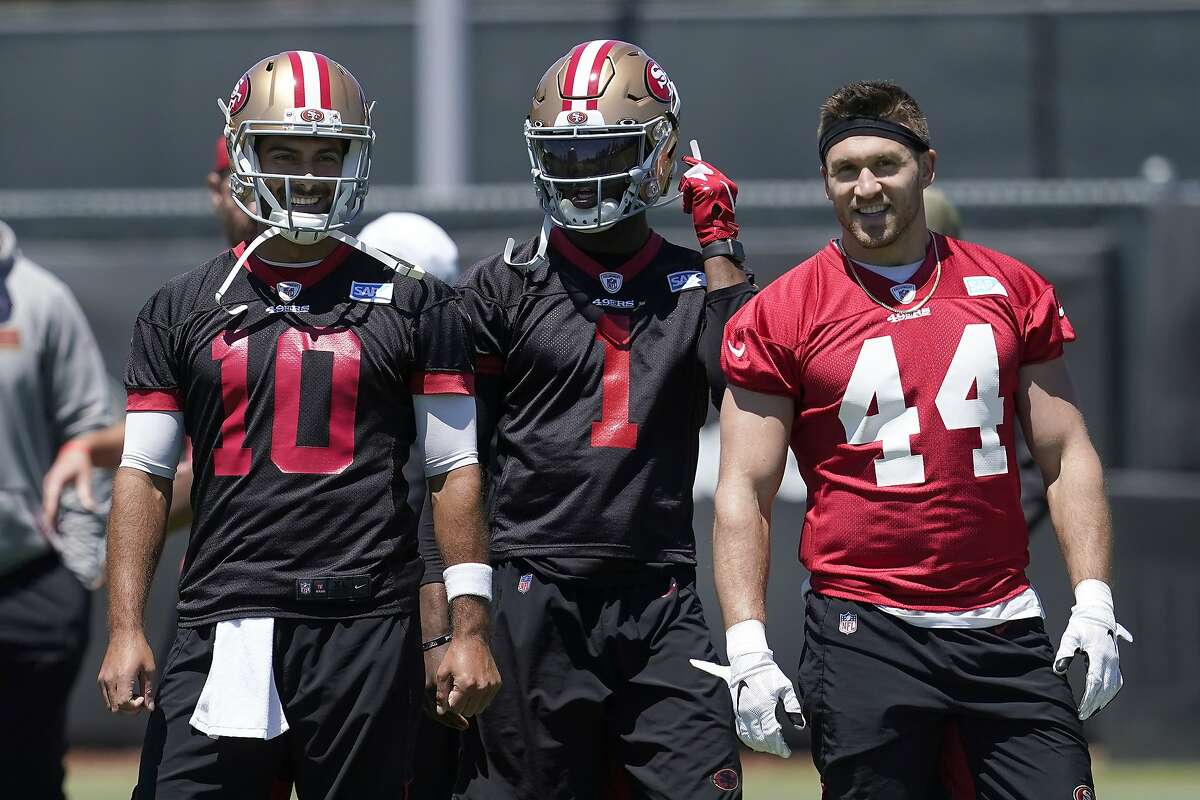 49ers quarterback Jimmy Garoppolo (10) with quarterback Josh Johnson (1) and fullback Kyle Juszczyk in Santa Clara.