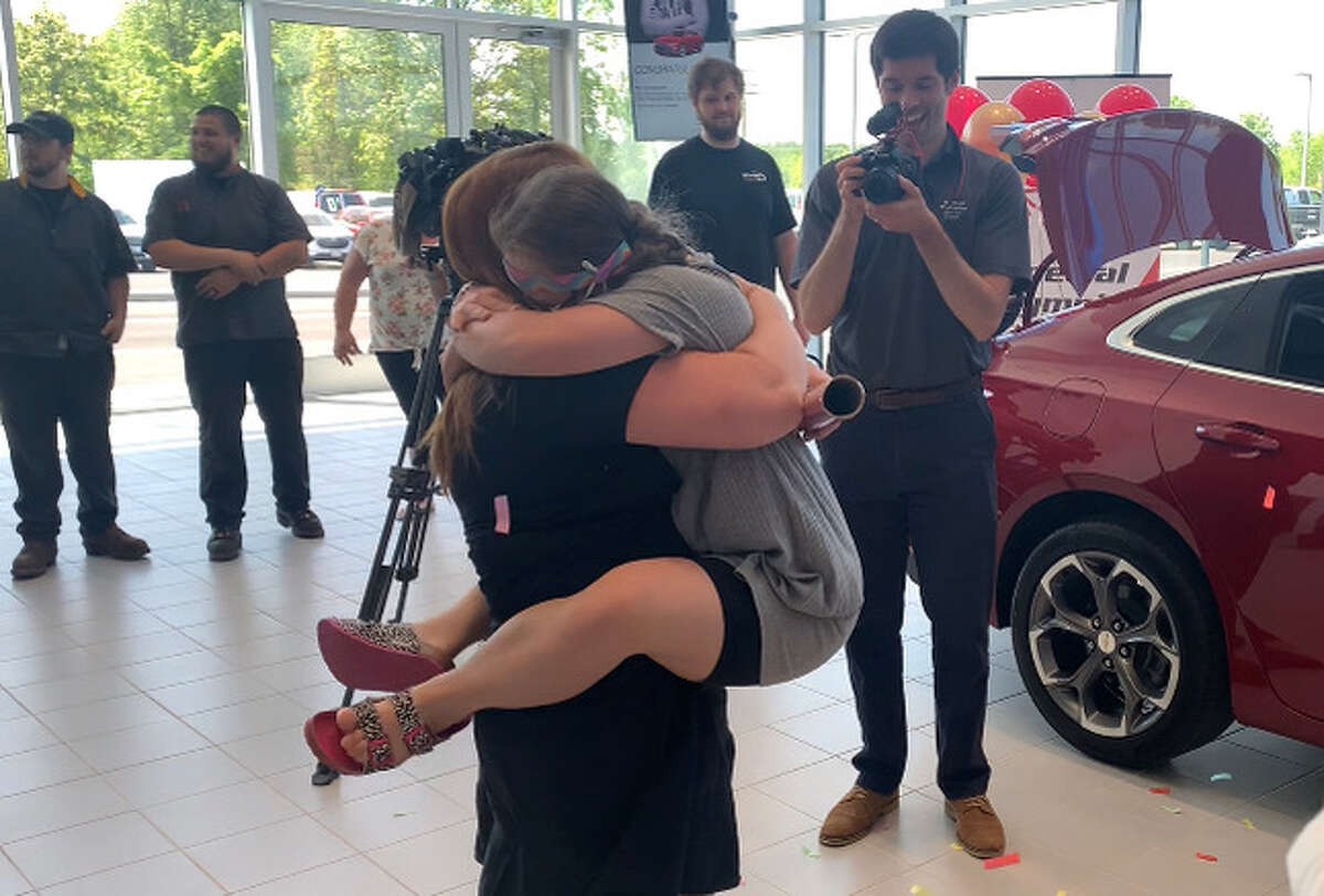 Izzy Brinkerhoff hugs her gymnastics coach Marlene Michels after she learns she will compete in the Special Olympics USA Games in 2022.